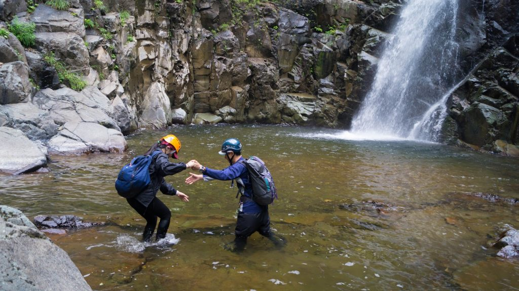 Hikers guided into pool at Anmon Falls